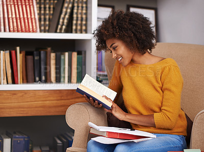 Buy stock photo Cropped shot of an attractive young woman reading a book