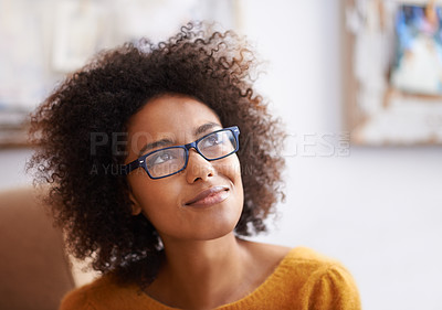 Buy stock photo Cropped shot of an attractive young woman looking thoughtful