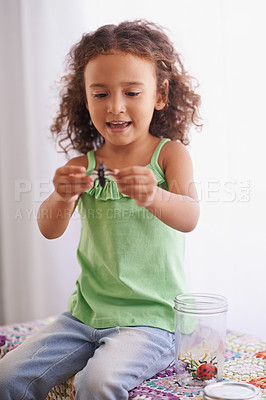 Buy stock photo Shot of a little girl having fun with her toys