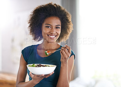 Buy stock photo Portrait of an attractive young woman eating a bowl of salad