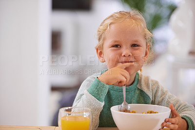 Buy stock photo Portrait of a cute little girl eating breakfast at home