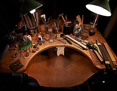 Buy stock photo A high angle view of a wooden desk covered in tools