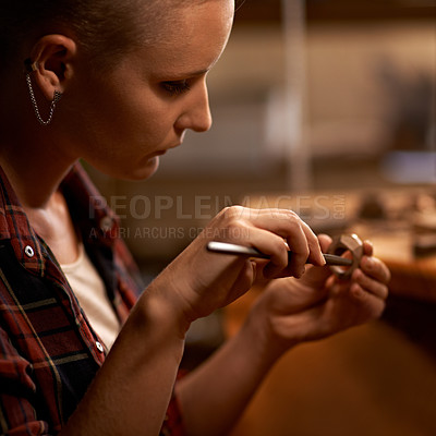 Buy stock photo Closeup of a young woman working with tools at a woodwork station