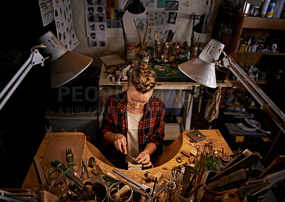 Buy stock photo Aerial shot of a young woman working at her work bench