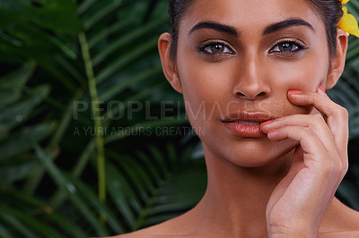 Buy stock photo A portrait of a beautiful woman wearing flowers in her hair in the jungle