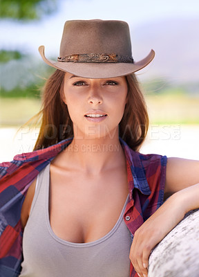 Buy stock photo A beautiful cowgirl standing outdoors on a Summer's day