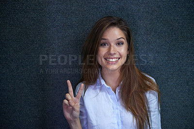 Buy stock photo Portrait of a beautiful young businesswoman giving a peace sign
