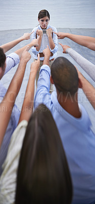 Buy stock photo Shot of an anxious young woman facing the accusatory fingers of her coworkers