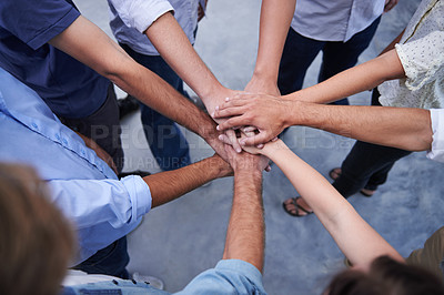 Buy stock photo High angle shot of a business team putting their hands together