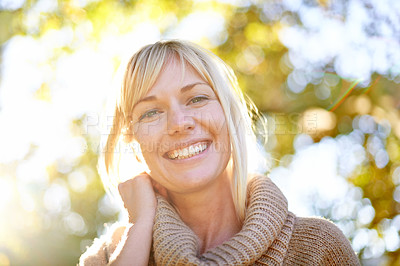 Buy stock photo A low angle portrait of a beautiful woman outdoors in the park