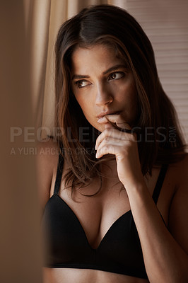 Buy stock photo A beautiful woman wearing lingerie and looking thoughtful