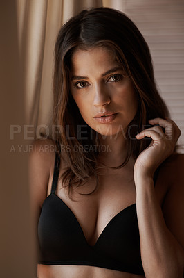 Buy stock photo A beautiful woman in lingerie standing looking serious