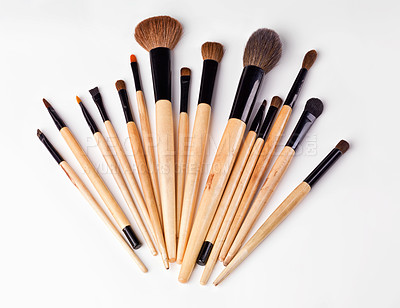 Buy stock photo An isolated shot of s set of makeup brushes