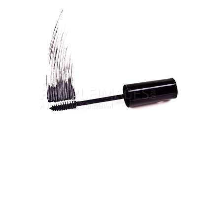 Buy stock photo Studio shot of a mascara brush smearing makeup against a white background