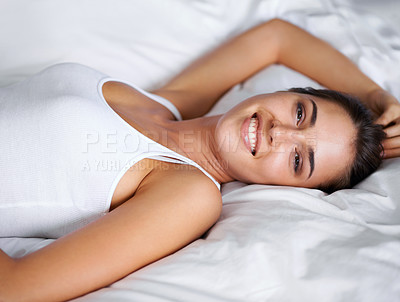 Buy stock photo Portrait of a beautiful young woman lying in bed