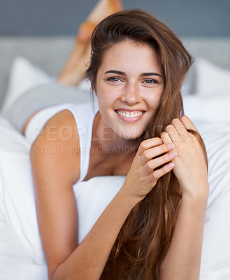 Buy stock photo Portrait of a happy young woman lying in bed