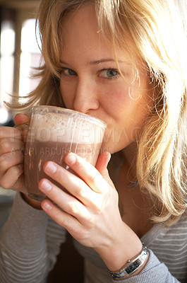 Buy stock photo Pretty young woman enjoying a hot cup of cacao - portrait