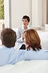 A financial planner speaking to a couple at home
