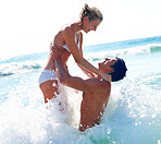 Cute young couple enjoying at the sea shore on a summer day