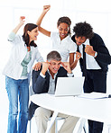 Team of happy business people working together on a laptop