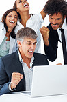 Team of successful business people working together on a laptop