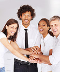 Team of confident business people with their hands together