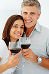 Closeup of a mature couple drinking a glass of wine together