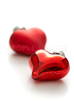 Buy stock photo Closeup of two heart-shaped christmas decorations on a white background with copyspace