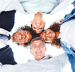 Upward view of happy business people with their heads together on a white background