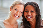 Closeup of an African American woman with her blond friend
