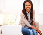 Comfortable young woman with laptop in an apartment