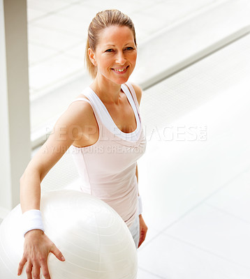 Fit mature female holding a fitness ball