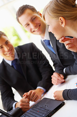 Buy stock photo Cropped shot of a group of corporate businesspeople talking together over a laptop
