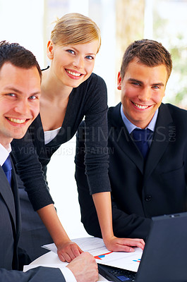 Buy stock photo Portait of a group of corporate businesspeople talking together over paperwork
