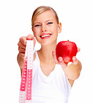 Portrait of cute young female holding red apple and measuring tape