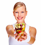 Portrait of happy young female holding glass full of mixed fruits over white background