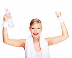 Portrait of excited young female with arms raised and water bottle in hand