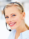 Attractive young woman talking over headset