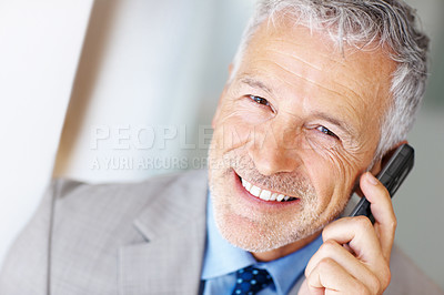 Buy stock photo Shot of a business man talking on his cellphone
