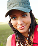 Portrait of young female student listening to music