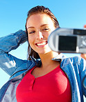 Cheerful young woman taking self portrait