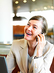 Business concepts - laughing woman talking on cell