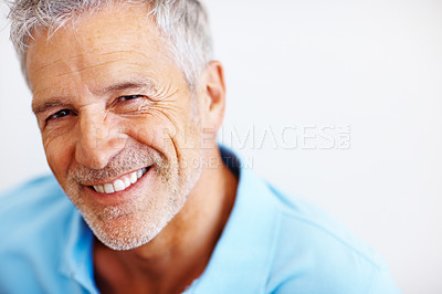 Buy stock photo Portrait of happy mature man smiling while isolated on white