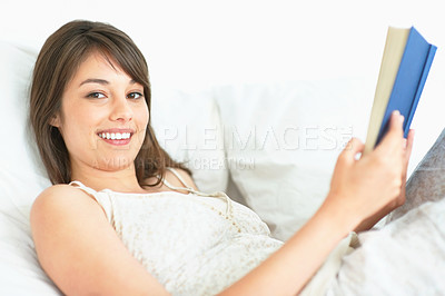 Buy stock photo Beautiful young female reading a book