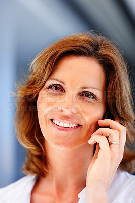 Buy stock photo Pretty young lady speaking on mobile phone
