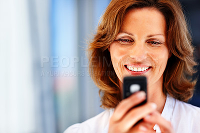 Buy stock photo Happy young woman text messaging on mobile