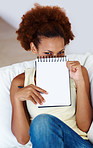 I have my own plans - Woman covering face with notepad