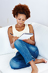 Relaxed woman writing in book