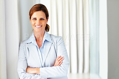 Buy stock photo Young business woman standing with folded hand