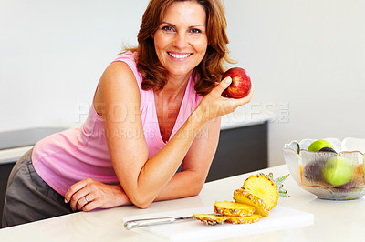 Buy stock photo Beautiful young woman holding an apple - Kitchen